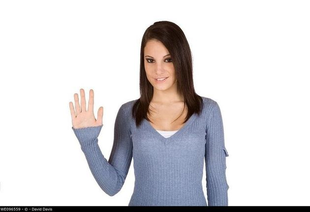 Beautiful Caucasian teenager counting on fingers on green