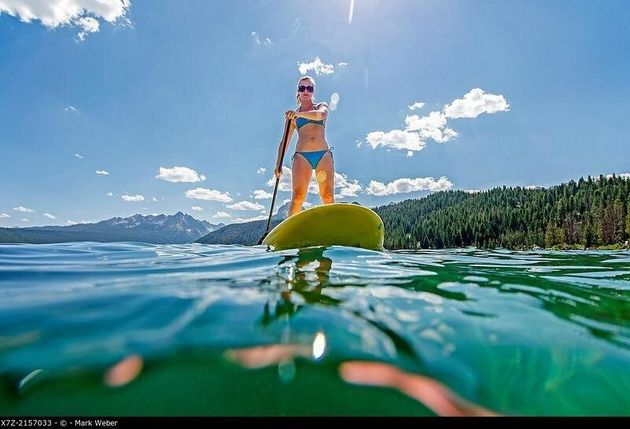touring on the Stand Up Paddle Board at Redfish Lake in the Sawtooth Mountains near the town of Stanely...