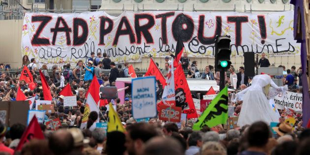Protesters hold placards and banners during a demonstration by French unions and the France