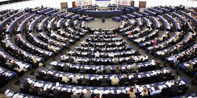 Strasbourg, FRANCE: European Deputies vote during the plenary session, at the European Parliament's Hemicycle...