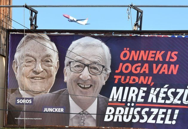 A picture taken on February 26, 2019 in Budapest shows a billboard bearing portraits of European Commission...