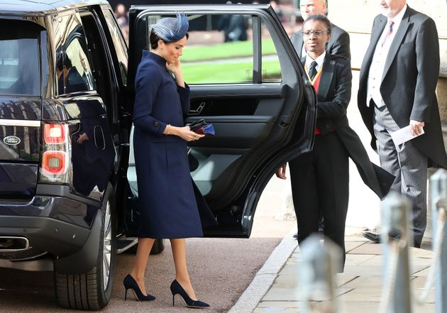 Britain's Meghan, Duchess of Sussex arrives to attend the wedding of Britain's Princess Eugenie of York...