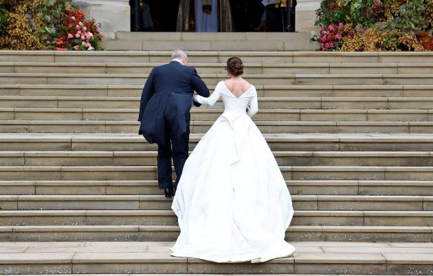 Britain's Princess Eugenie arrives accompanied by her father Prince Andrew, Duke of York, at St George's...