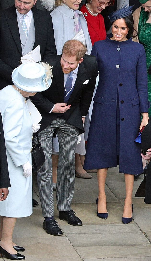 Britain's Queen Elizabeth II (L) talks with Britain's Prince Harry, Duke of Sussex, and Meghan, Duchess...