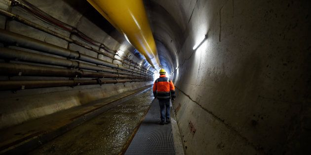 A worker is seen in the tunnel of a high-speed train line, known as TAV (Treno Alta Velocita) in Chiomonte,...
