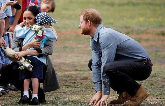 Five year old Luke Vincent couldn't resist the lure of the royal beard after the Duke and Duchess of...