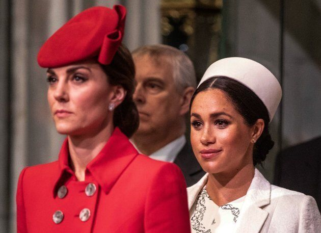 Britain's Meghan, Duchess of Sussex (R) and Britain's Catherine, Duchess of Cambridge, (L) attend the...