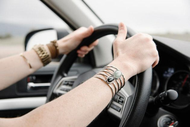 A woman with her hands on the driver's