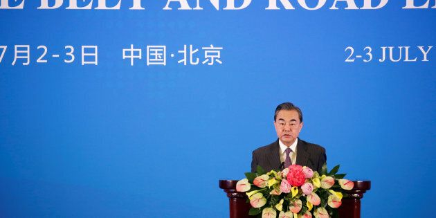 China's Foreign Minister Wang Yi delivers a speech at an international forum on