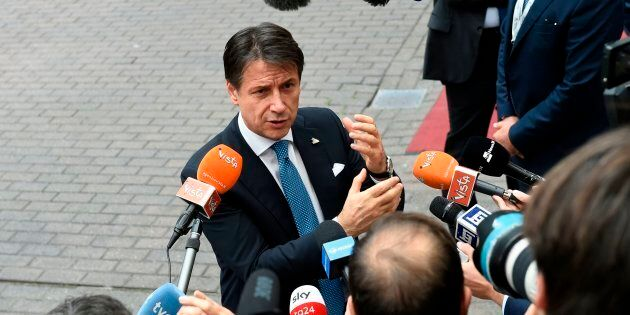 Italy's Prime Minister Giuseppe Conte gestures as he addresses media representatives after an EU - Korea...