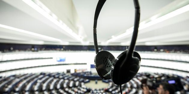 A translator earphone stands on a glass at the European Parliament during a plenary session in Strasbourg,...