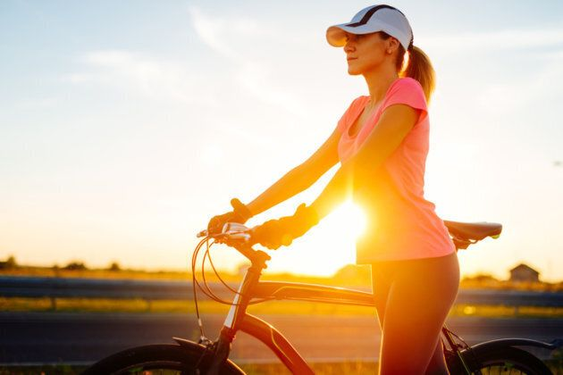 Image of young female athlete in sports clothing, exercising and doing recreational training outdoors,...