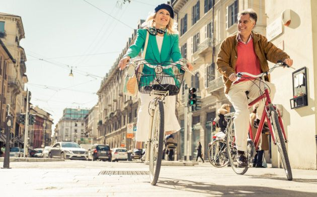 Senior couple riding their bicycle in the city