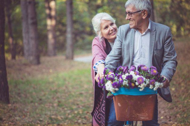Senior couple in the park on an autumns