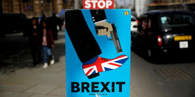 Placards placed by anti-Brexit supporters stand opposite the Houses of Parliament in London, Monday,...