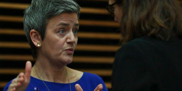 European Competition Commissioner Margrethe Vestager, left, talks to Trade Commissioner Cecilia Malmstrom...