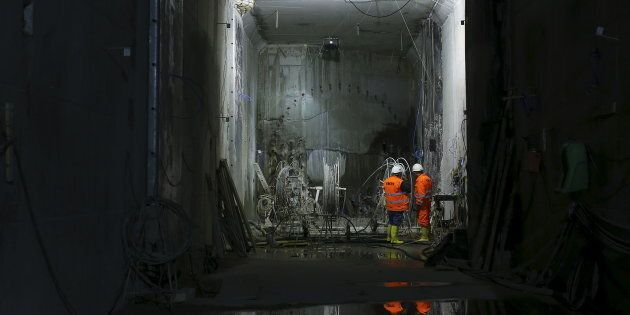 Workers are seen at the site of a metro railway tunnel under construction at