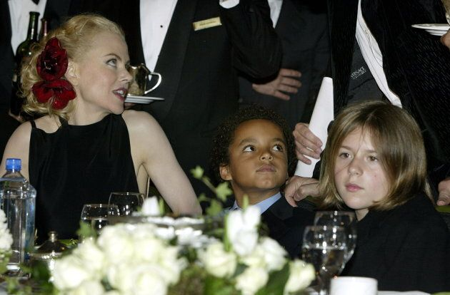 Actress Nicole Kidman and her children son Connor (C) and daughter Isabella sit at the dias as they attend...