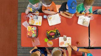 BUXTON, ME - JULY 12: Children in the Buxton summer recreational program eat lunch at a cafeteteria at Buxton Center Elementary School in Buxton on Thursday, July 12, 2018. About 1 in 5 children in Maine struggle with hunger and more summer meal programs are starting across the state to keep children fed when they're not in school. (Staff photo by Gregory Rec/Portland Press Herald via Getty Images)