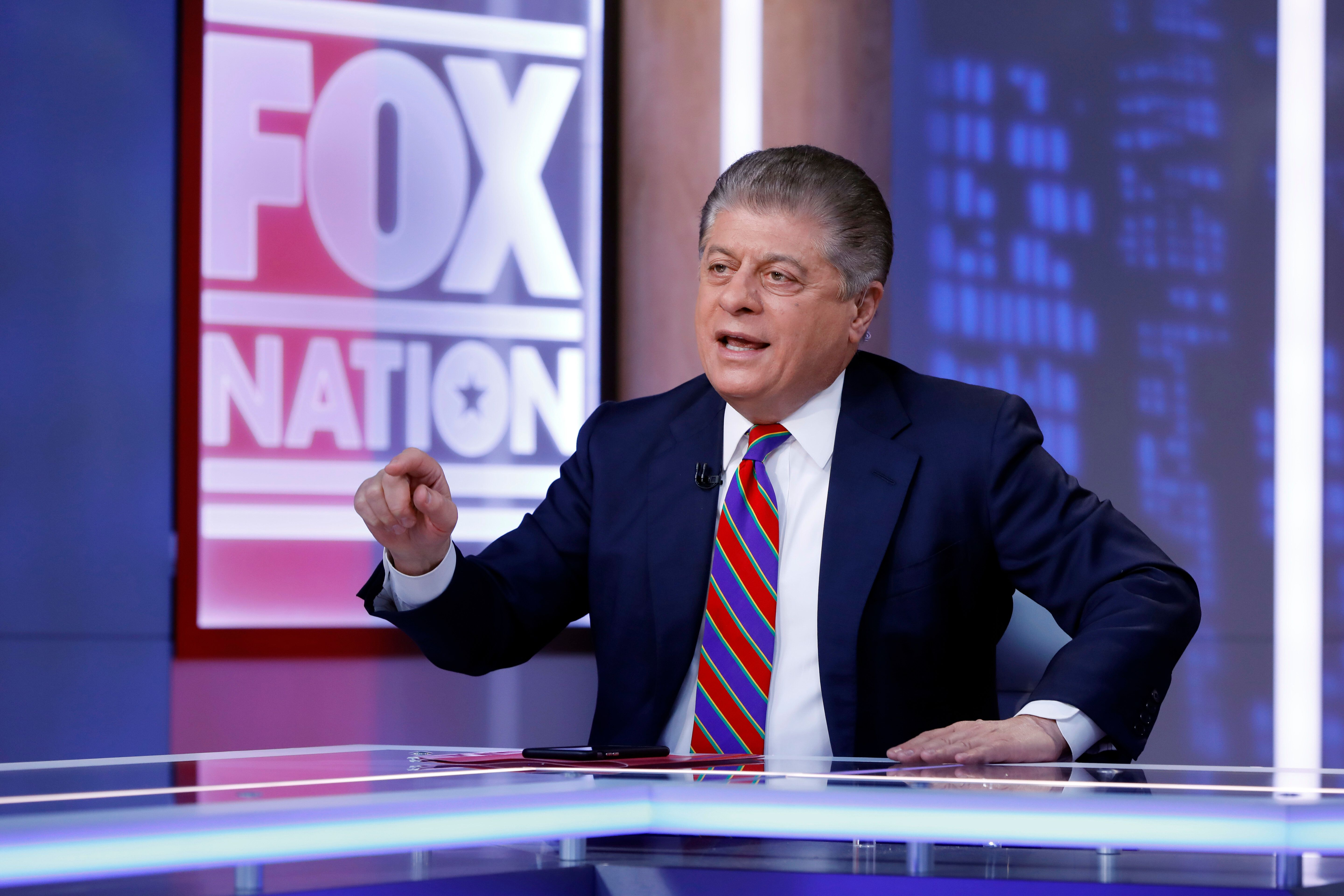 """Fox News senior judicial analyst Andrew Napolitano hosts the inaugural broadcast of """"Liberty File"""" on the new streaming service Fox Nation, in New York, Tuesday, Nov. 27, 2018. Fox is becoming the latest television news operation to stake out digital turf. Rather than an attempt to seek out young cord-cutters, Fox Nation is a subscription-based service designed to complement Fox News Channel. (AP Photo/Richard Drew)"""