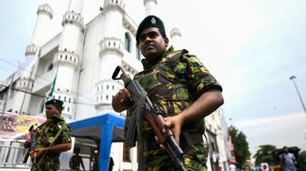 TOPSHOT - Soldiers stand guard outside a mosque ahead of the Friday noon prayer in Colombo on April 26, 2019, following a series of bomb blasts targeting churches and luxury hotels on Easter Sunday in Sri Lanka. - Authorities in Sri Lanka on April 25 lowered the death toll in a spate of Easter bombings by more than 100 to 253, admitting some of the badly mutilated bodies had been erroneously double-counted. (Photo by Jewel SAMAD / AFP)        (Photo credit should read JEWEL SAMAD/AFP/Getty Images)
