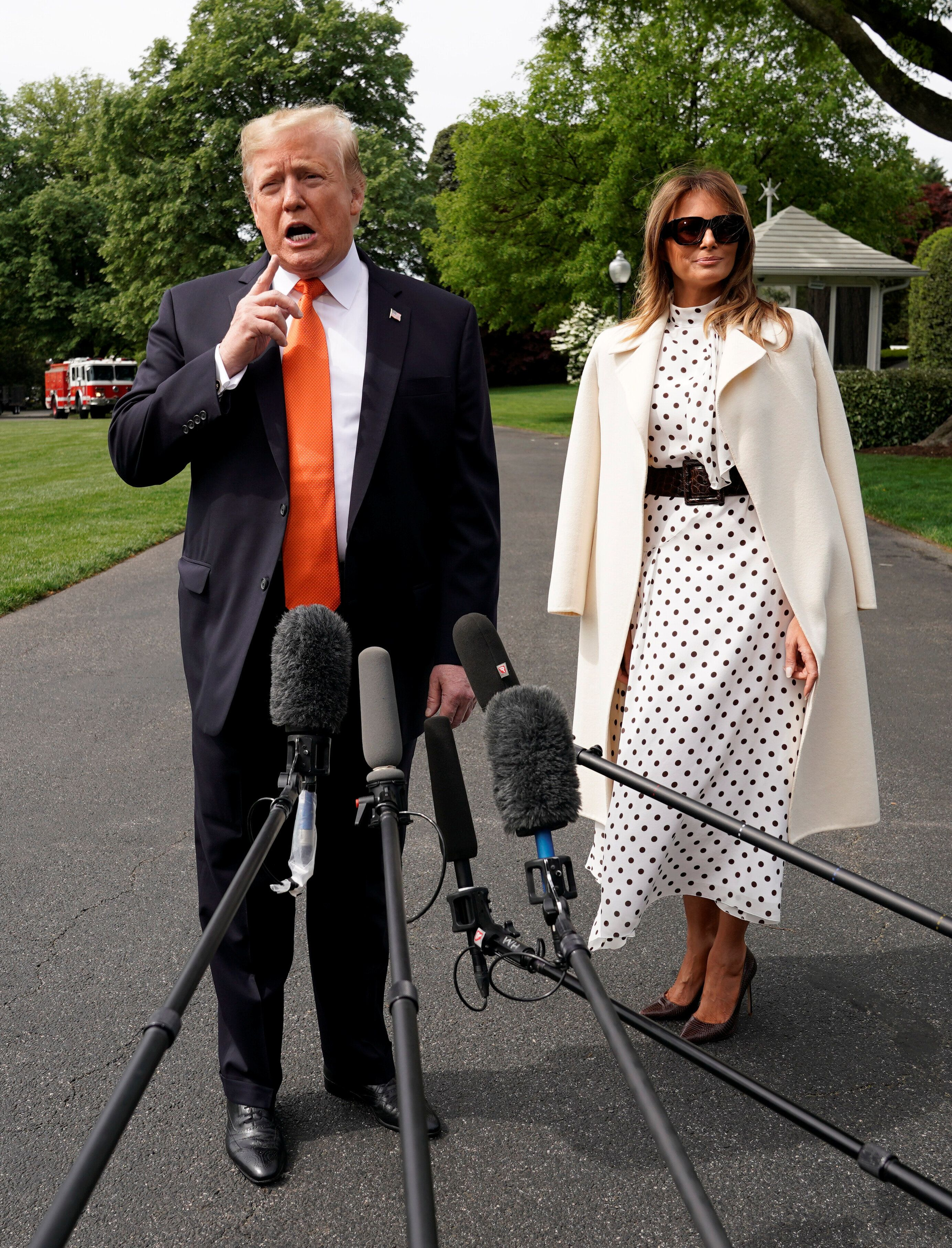 U.S. President Donald Trump speaks to reporters as he and first lady Melania Trump depart the White House in Washington, U.S., April 24, 2019. REUTERS/Kevin Lamarque