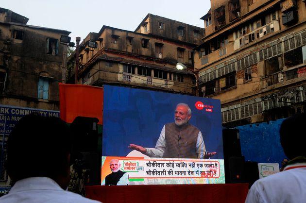 People attend Prime Minister Narendra Modi's 'Mai Bhi Chowkidar' event, through a video conference initiative...