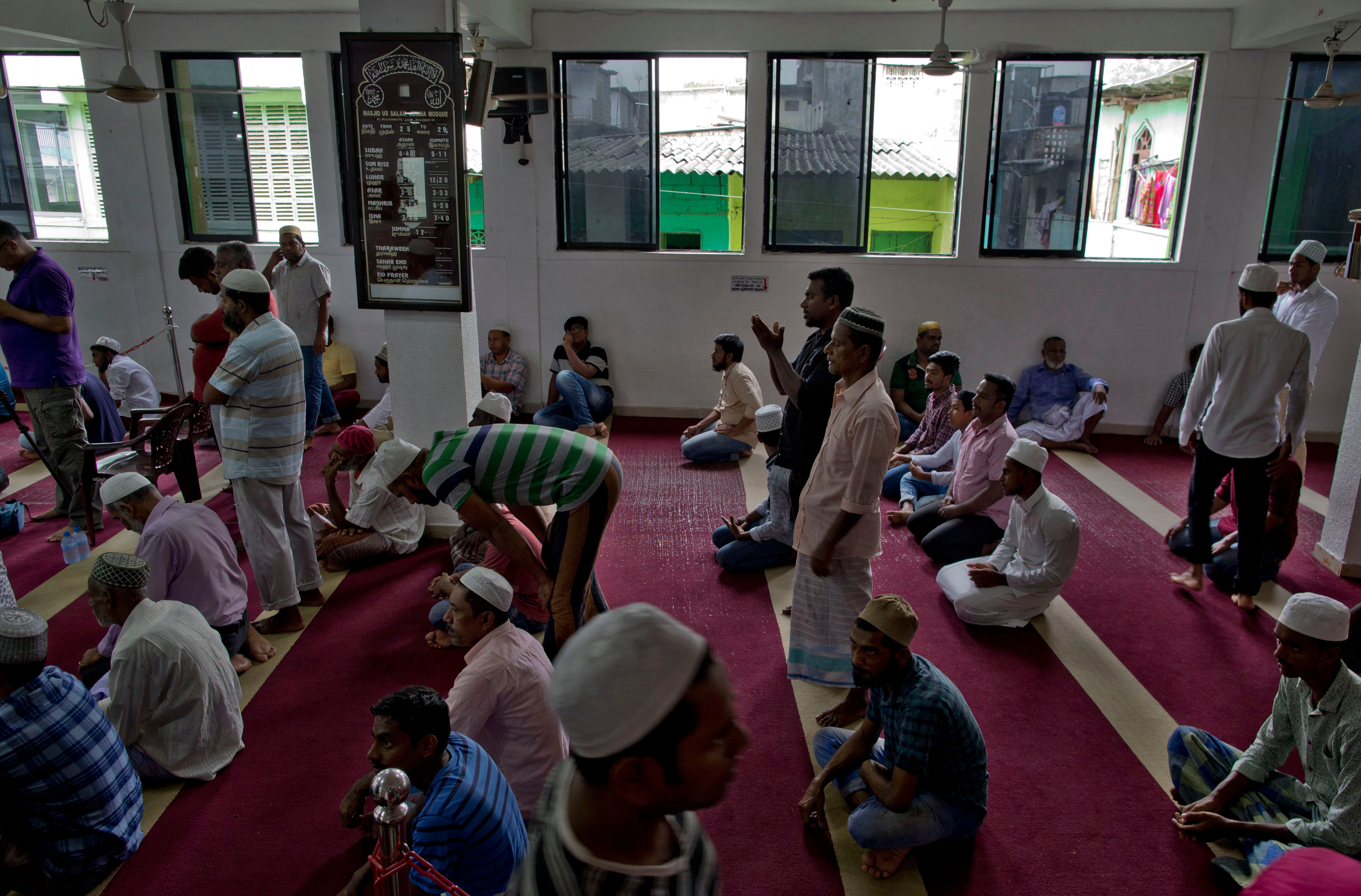 Muslim men gather to pray at a mosque in Colombo, Sri Lanka, Friday, April 26, 2019. Hundreds gathered at mosques that conducted Friday prayer services despite warnings of more bomb attacks by Islamic State-claimed militants. And while praying through tears to Allah to help their fellow countrymen, all stressed one thing. The Easter attacks targeting churches and hotels that killed at least 250 people came from people who didn't truly believe the teachings of Islam. (AP Photo/Gemunu Amarasinghe)