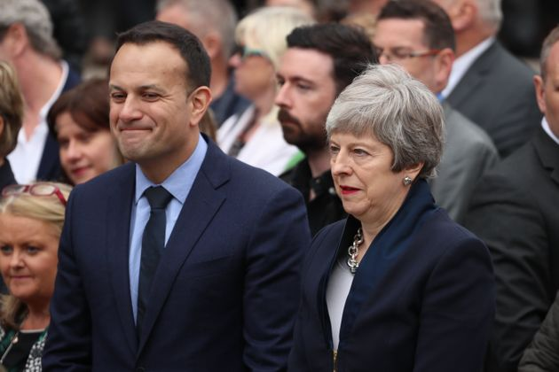 Irish Taoiseach Leo Varadkar and UK Prime Minister Theresa May leave the funeral service of murdered...