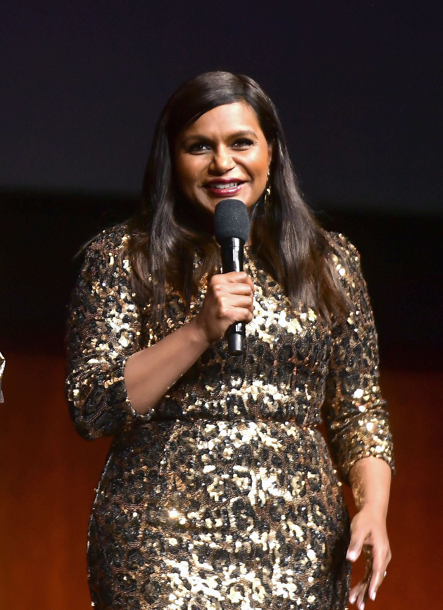 "LAS VEGAS, NV - APRIL 03:  Mindy Kaling speaks onstage at CinemaCon 2019- Amazon Studios Invites You to an Exclusive Screening of ""Late Night"" at The Colosseum at Caesars Palace during CinemaCon, the official convention of the National Association of Theatre Owners, on April 3, 2019 in Las Vegas, Nevada.  (Photo by Matt Winkelmeyer/Getty Images for CinemaCon)"
