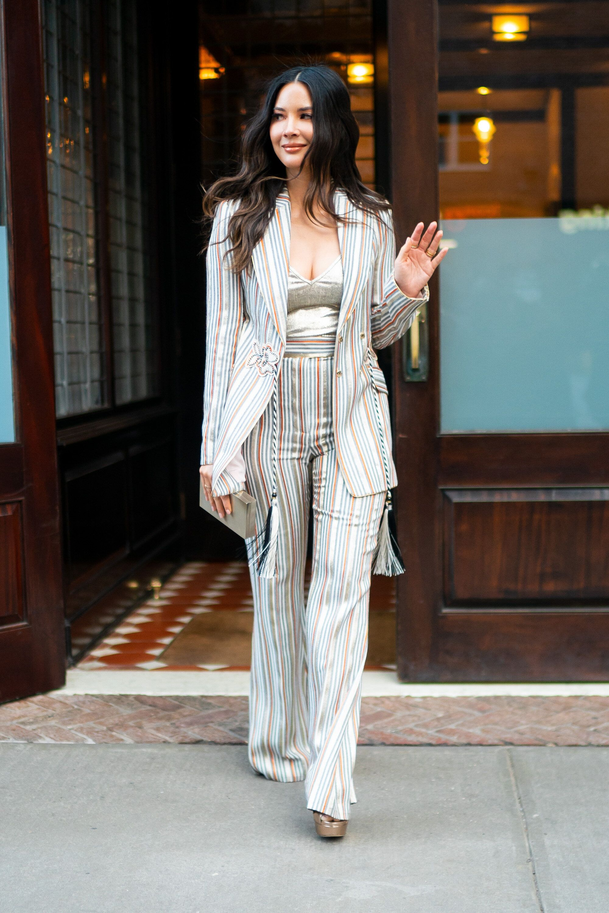 Olivia Munn in a striped suit that recently suffered the barbs of snarky fashion blog Go Fug Yourself.