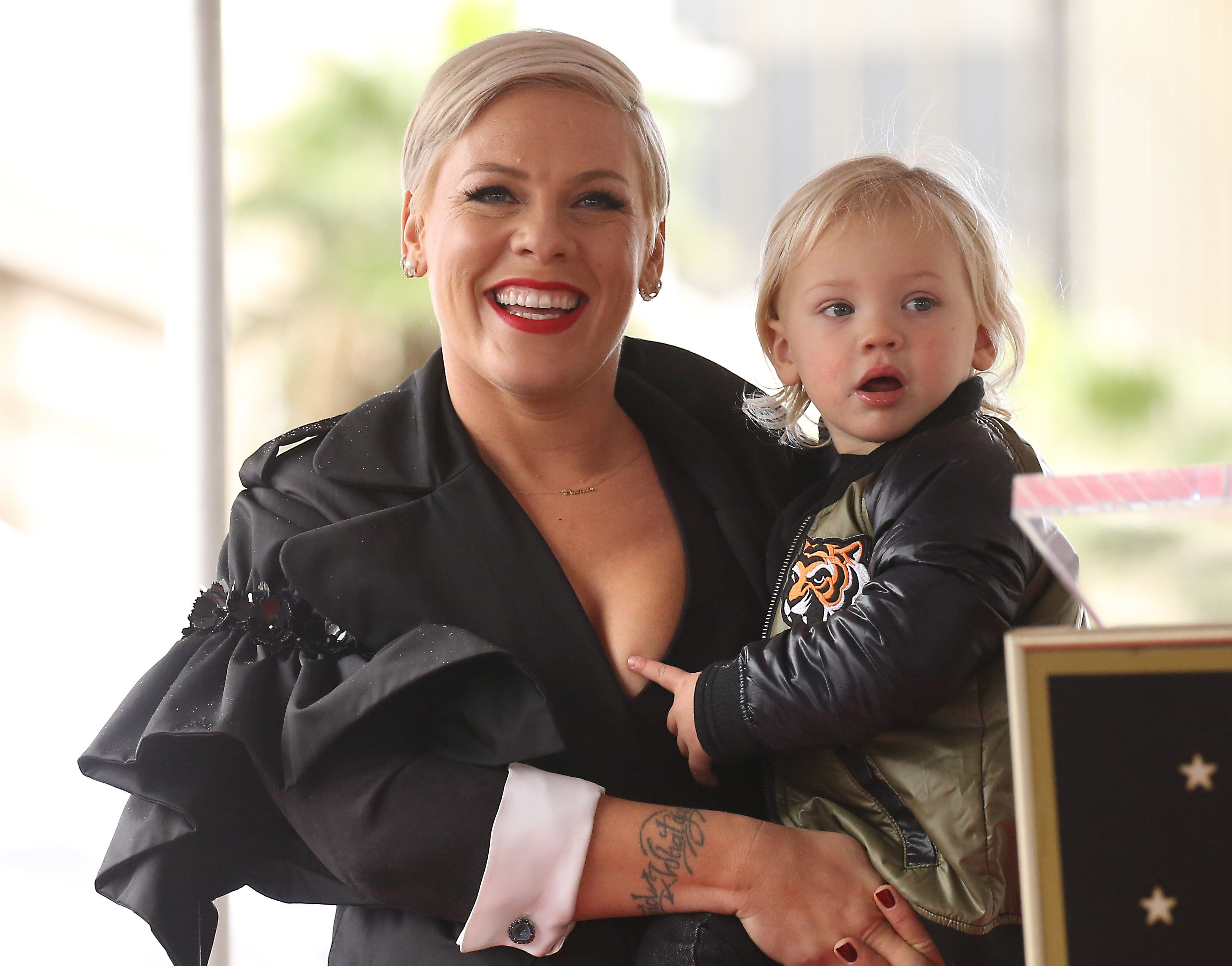 HOLLYWOOD, CALIFORNIA - FEBRUARY 05: Alecia Beth Moore aka Pink with her son, Jameson Moon Hart attend the ceremony honoring Pink with a Star on The Hollywood Walk of Fame held on February 05, 2019 in Hollywood, California. (Photo by Michael Tran/FilmMagic)