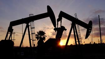 This Thursday March 6, 2014 photo shows the setting sun behind pumpjacks operating at the Inglewood oil fields in the Baldwin Hills area of Los Angeles. The Los Angeles City Council has taken steps to prohibit hydraulic fracturing, or fracking. (AP Photo/Richard Vogel)