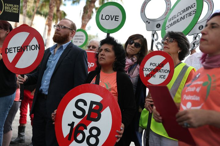 """Immigrant rights activists in Miramar, Florida, held signs protesting the """"anti-sanctuary"""" bills moving through the Florida L"""