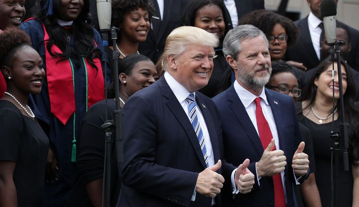 President Donald Trump and Jerry Falwell Jr., president of Liberty University, with members of a gospel choir during a May 13
