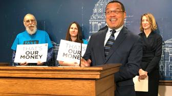 Minnesota Attorney General Keith Ellison speaks at a news conference at the state Capitol in St. Paul, Minnesota, Tuesday, April 23, 2019, about the impact of a 2017 state law repealing the state's ban on for-profit health insurance companies. (AP Photo/Steve Karnowski)