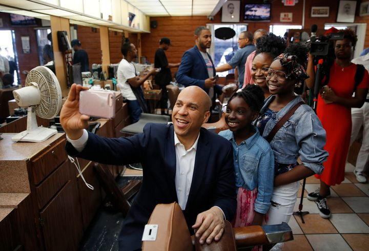 New Jersey Sen. Cory Booker campaigns in a barbershop in Nevada earlier this month. Booker is one of several candidates tryin