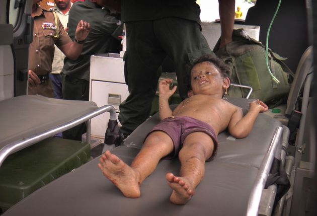 A Sri Lankan girl is taken to hospital after he was found at the site of an explosion and a gunbattle...
