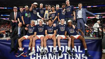 MINNEAPOLIS, MINNESOTA - APRIL 08:  The Virginia Cavaliers celebrate with the trophy after their 85-77 win over the Texas Tech Red Raiders during the 2019 NCAA men's Final Four National Championship game at U.S. Bank Stadium on April 08, 2019 in Minneapolis, Minnesota. (Photo by Tom Pennington/Getty Images)