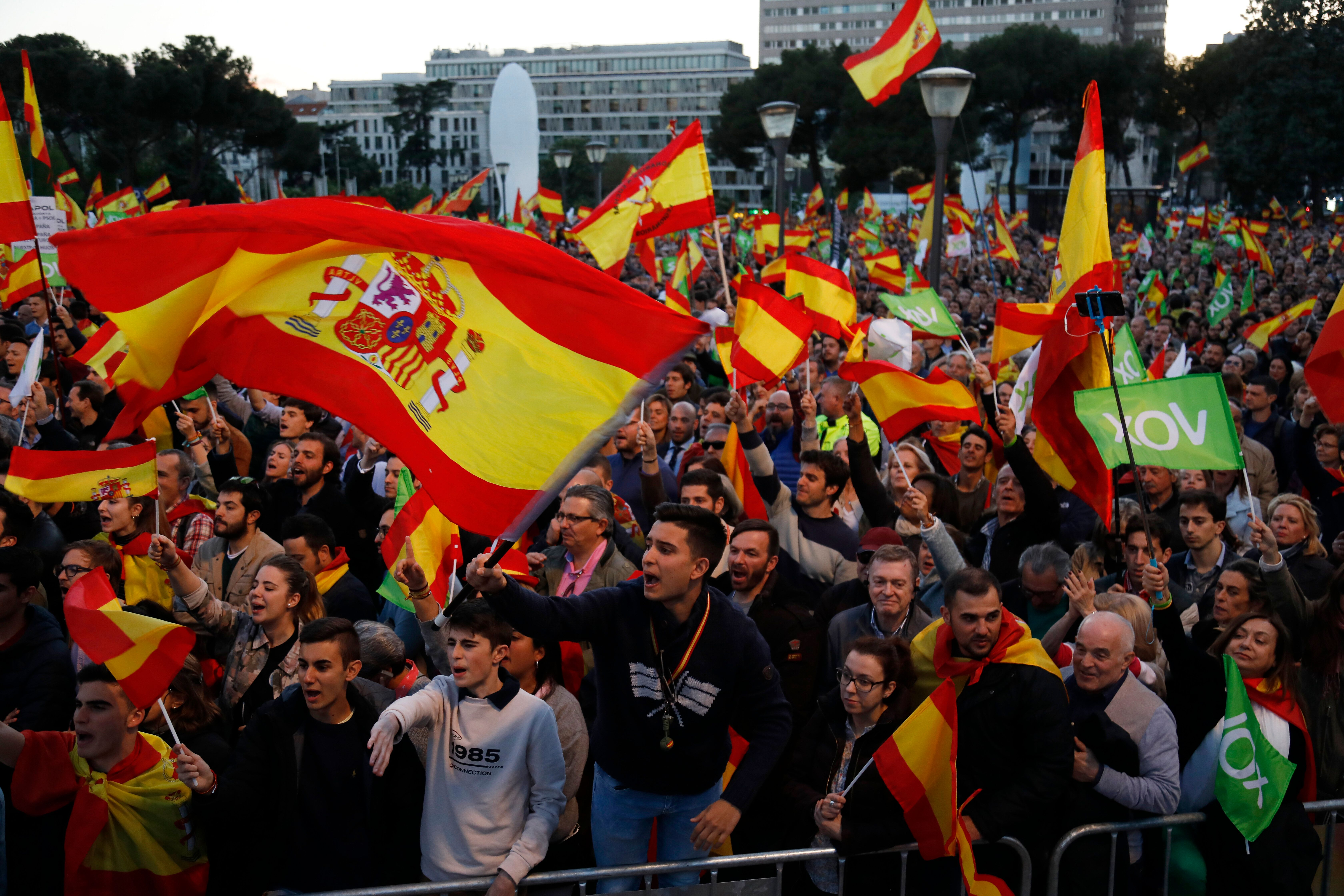 MADRID, SPAIN - APRIL 26: Supporters take part in the VOX closing rally on April 26, 2019 in Madrid, Spain. Spaniards go to the polls to elect 350 members of the parliament and 208 senators this Sunday. This will be the 13th General Election since the transition to democracy resulting in the Constitution of 1978. There are five main parties: the two traditional parties are the right-wing Partido Popular (People's Party) and the centre-left Partido Socialista Obrero Espanol or PSOE (Spanish Socialist Workers's Party), along with right-wing parties Ciudadanos (Citizens) and VOX and the left wing party, Unidas Podemos (United We Can). (Photo by Pablo Blazquez Dominguez/Getty Images)