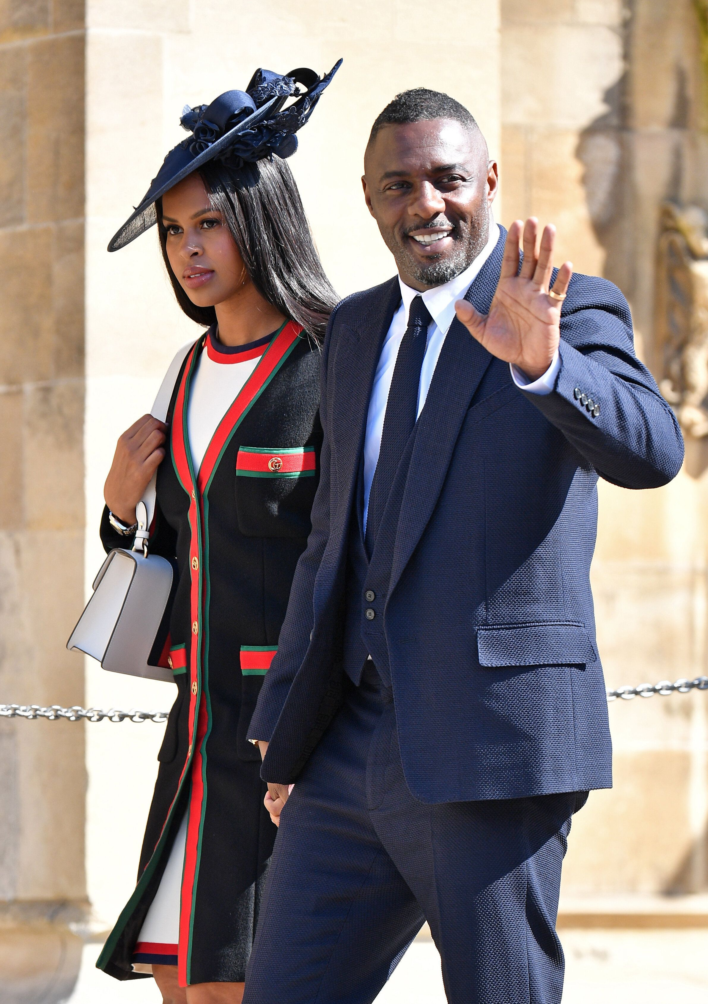 WINDSOR, UNITED KINGDOM - MAY 19: (EMBARGOED FOR PUBLICATION IN UK NEWSPAPERS UNTIL 24 HOURS AFTER CREATE DATE AND TIME) Sabrina Dhowre and Idris Elba attend the wedding of Prince Harry to Ms Meghan Markle at St George's Chapel, Windsor Castle on May 19, 2018 in Windsor, England. Prince Henry Charles Albert David of Wales marries Ms. Meghan Markle in a service at St George's Chapel inside the grounds of Windsor Castle. Among the guests were 2200 members of the public, the royal family and Ms. Markle's Mother Doria Ragland. (Photo by Pool/Max Mumby/Getty Images)