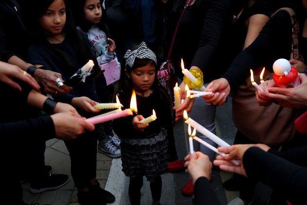 A girl among people during a vigil, outside of the presidential palace in Nicosia, Cyprus, on