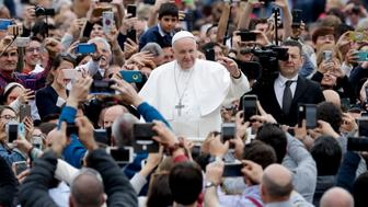Pope Francis waves to the crowd after celebrating Ester Mass in St. Peter's Square at the Vatican, Sunday, April 21, 2019. Pope Francis celebrated Easter Mass on Sunday, marking the most joyful moment of the year for the faithful even as the church faced a fresh round of bloodshed targeting Christians in Sri Lanka. (AP Photo/Andrew Medichini)