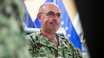 "FILE - In this Wednesday, April 17, 2019, file photo reviewed by U.S. military officials, U.S. Navy Rear Adm. John Ring, Joint Task Force Guantanamo Commander, pauses while speaking during a roundtable discussion with the media, at Guantanamo Bay Naval Base, Cuba. Military officials say that Ring has been fired for a ""loss of confidence in his ability to command."" A statement from U.S. Southern Command says Ring was relieved of duty Saturday, April 27. (AP Photo/Alex Brandon, File)"