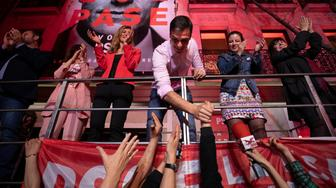 Spain's Prime Minister and Socialist Party leader Pedro Sanchez shakes hands with supporters outside the party headquarters following the general election in Madrid, Spain, Sunday, April 28, 2019. (AP Photo/Bernat Armangue)