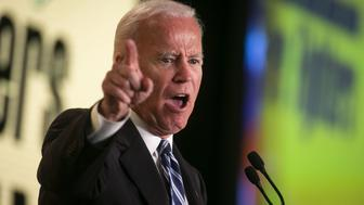 "Former U.S. Vice President Joe Biden gestures while speaking during the International Association of Fire Fighters (IAFF) Legislative Conference in Washington, D.C., U.S., on Tuesday, March 12, 2019. Biden told a key labor ally he may need their energy ""in a few weeks,"" as he nears a decision on whether to join a crowded Democratic field for what would be his third run for president. Photographer: Al Drago/Bloomberg via Getty Images"