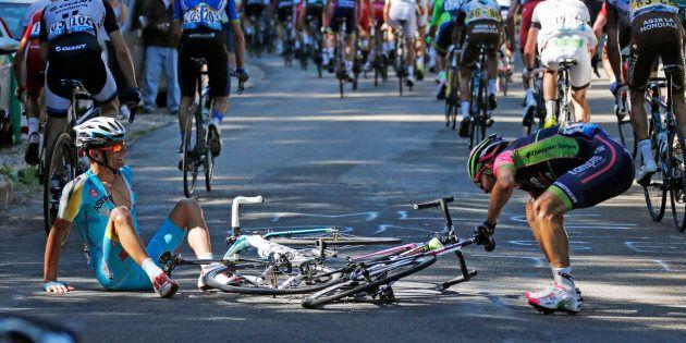 Astana team rider Michele Scarponi of Italy and Lampre-Merida team rider Jose Rodolfo Serpa of Colombia...