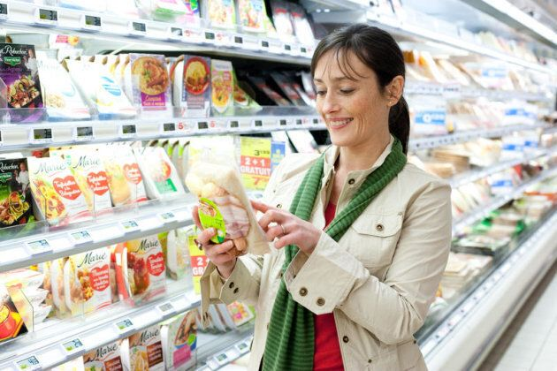 Woman shopping in the prepared food section in supermarket. Woman shopping in the prepared food section...