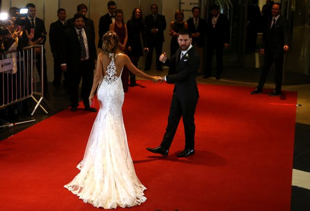 Argentine soccer player Lionel Messi and his wife Antonela Roccuzzo pose at their wedding in Rosario,...