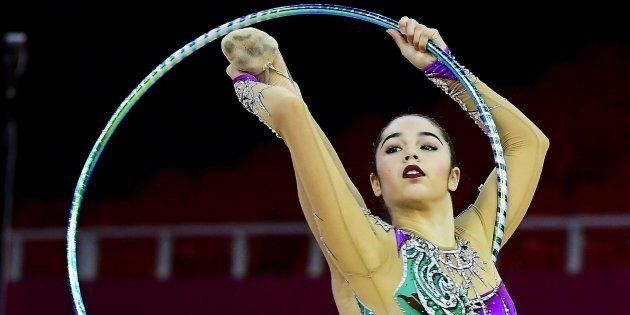 epa05974586 Alexandra Agiurgiuculese of Italy performs with the hoop during the individual qualification...